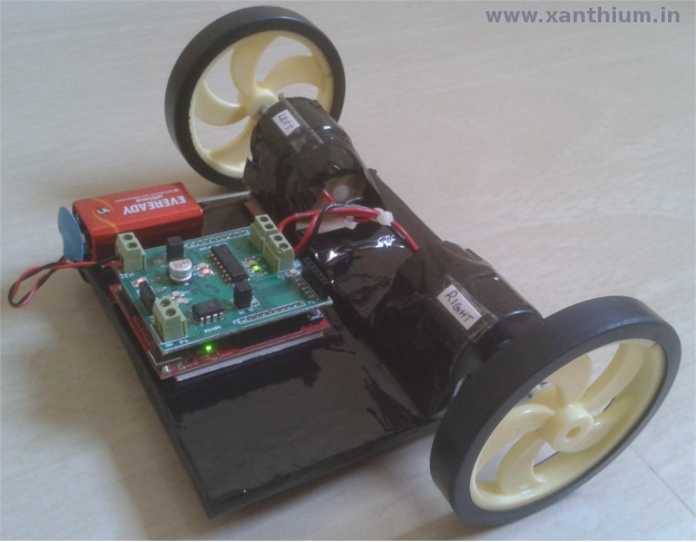 picture of a robot made from MSP430 Launchpad and Robot booster pack sold at this site.